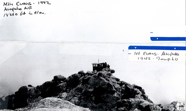 Temporary Lookout building at summit of Mt. Evans to determine the value of high altitude observations vs. those from stations at lower elevations. 8/14/42 F.R Johnson - Arapho N.F.